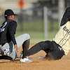 Blasters player xx xxx (10) safely steals second base as New Jersey's xx xxx (52) tries to apply the tag during their game on Thursday night at Wardog Stadium in Miami.<br /> Globe | Laurie Sisk