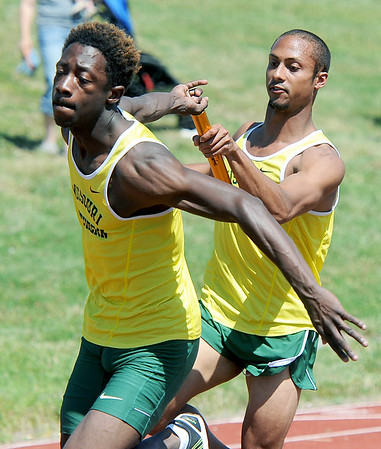 With a commanding lead, Missouri Southern's Jeff Fraley, right and Keson Payton can't complete the exchange and drop the baton during the men's 4x100 relay on Friday at MSSU