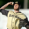 Blasters pitcher xx xx (43) hurls the ball toward the plate during the Blasters' exhibition game against the New Jersey Black Sox on Thursday night at Wardog Stadium in Miami.<br /> Globe | Laurie Sisk