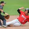 Wichita's T.J. Mittelsaedt safely steals second base as Blasters second baseman Mitch Glasser awaits the throw during their game on Wednesday night at Joe Becker Stadium.<br /> Globe | Laurie Sisk