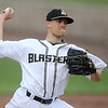 Blasters' starter xx xx (21) deals from the mound during Joplin's home opener against the Winnipeg Goldeyes on Thursday night at Joe Becker Stadium.<br /> Globe | Laurie Sisk