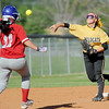 Diamond's Whitney DeGonia turns a successful double play as Liberal's Jaci Coleman runs to second base during their Class1, District 11 championship game on Wednesday at Diamond.<br /> Globe | Laurie SIsk