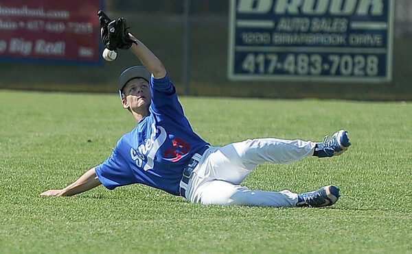 Seneca centerfielder Gavin Clouse comes up just short on a diving catch during the Indians game against Carl Junction on Saturday at CJHS.<br /> Globe | Laurie Sisk