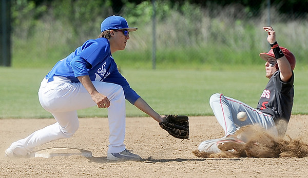 Carl Junction's Ryan Devore beats the ball to second base as Seneca's Blake Butler fields the throw during their game on Saturday at CJHS.<br /> Globe | Laurie Sisk