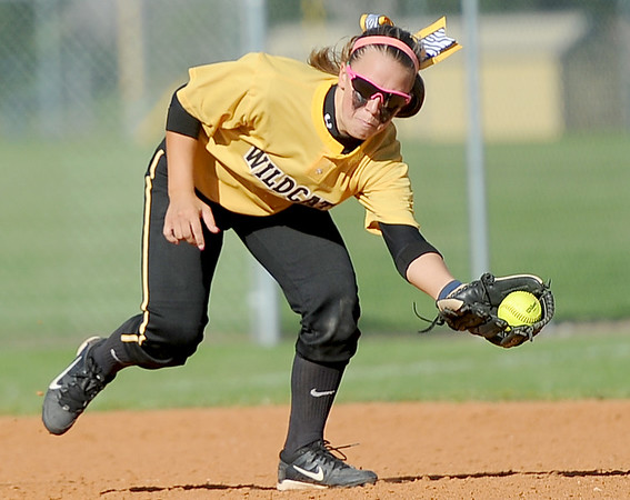 Diamond shortstop Whitney DeGonia gloves a hard groundball during the Wildcats' Class1, District 11 championship game against Liberal on Wednesday at Diamond. Globe | Laurie Sisk