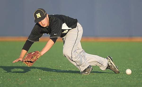 Neosho's Hank Selig can't quite catch up to a hard ground ball during the Wildcats'  Class 5, District 12 championship game against Webb City on Wednesday at Joplin High School.<br /> Globe | Laurie Sisk