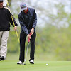 Globe/Roger Nomer<br /> Joplin's Landers Ramsey sinks a putt on Monday at Twin Hills.