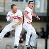 Channing Mickey, left and Calem Nutting celebrate at home plate after the Cardinals' 4-3 win over Neosho in the Class 5, District 12 championship game on Wednesday at Joplin High School.<br /> Globe | Laurie Sisk