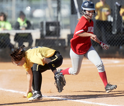 Liberal's Brooke Bearden races safely to first base as Diamond first baseman Amber Gray scoops up the ball during their Class1, District 11 championship game on Wednesday at Diamond.<br /> Globe   Laurie Sisk