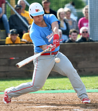Webb City's Channing Mickey connects for a single during the Cardinals' game against Kickapo on Tuesday night in Springfield.<br /> Globe   Laurie Sisk