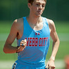 Webb City's Tad Capron lengthens his lead during the boys 1600m on Saturday at Carl Junction.<br /> Globe | Laurie Sisk