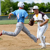 Webb City's Will Larson can't beat the throw to first as Kickapoo's Chandler Jones during their game on Tuesday night in Springfield.<br /> Globe | Laurie Sisk