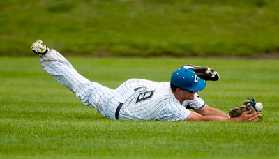 Crowder centerfielder xx xx (8) dives just short of catching a line drive to short center during the Roughriders' game against on Friday at Joe Becker Stadium. Globe | Laurie Sisk