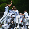 Globe/Roger Nomer<br /> Crowder players dogpile on starting pitcher Aaron Ashby following the final out of Monday's South Central District Championship at Warren Turner Field.