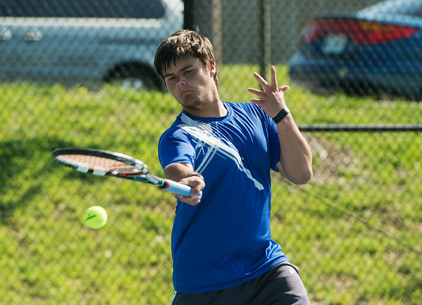 Globe/Roger Nomer<br /> Carthage's Austin Ward hits a shot during doubles competition at Joplin High on Monday.