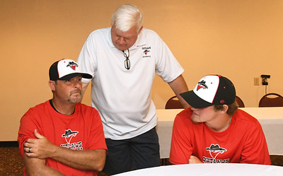 Outlaws coach David Weaver, left and his son, Danny Weaver, right, chat with Outlaws President and  General Manager Mark Rains during a special meet and greet for players and families on Wednesday night at the Continental Banquet Center. Globe | Laurie Sisk