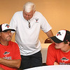 Outlaws coach David Weaver, left and his son, Danny Weaver, right, chat with Outlaws President and  General Manager Mark Rains during a special meet and greet for players and families on Wednesday night at the Continental Banquet Center.<br /> Globe | Laurie Sisk