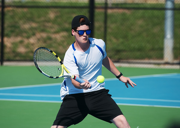 Globe/Roger Nomer<br /> Carthage's Elijah Paden hits a shot during doubles competition at Joplin High on Monday.