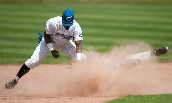 Crowder second baseman xx (4) looks for the ball in the dirt as St. Louis' xx (6) slides safely into second base for a double during their game on Friday at Joe Becker Stadium.<br /> Globe | Laurie Sisk