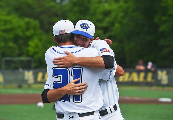 Globe/Roger Nomer<br /> Crowder's Joey Cooner (21) hugs Aaron Ashby, who pitched a complete game for Crowder, following their win against Seminole State in the South Central District Championship on Monday at Warren Turner Field.