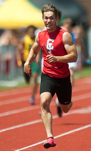 Weston Wendt brings home the win for the Carl Junction boys 4x200 relay on Saturday at CJHS. Globe | Laurie Sisk