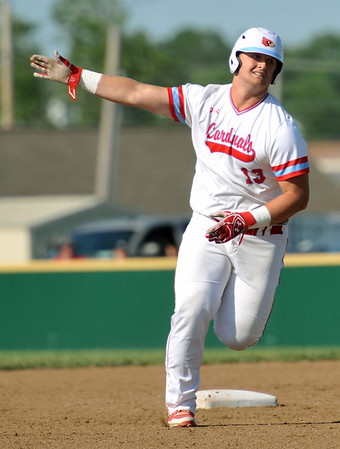Webb City's Channing Mickey rounds the bases after a two-run homerun during the Cardinals Class 5 District 12 championship game against Joplin on Tuesday night at Webb City.<br /> Globe | Laurie Sisk