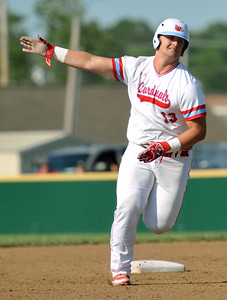 Webb City's Channing Mickey rounds the bases after a two-run homerun during the Cardinals Class 5 District 12 championship game against Joplin on Tuesday night at Webb City. Globe | Laurie Sisk