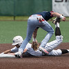 Globe/Roger Nomer<br /> Seminole State's Gunner Halter tags out Crowder's Jacob Adams at second on Monday at Warren Turner Field.