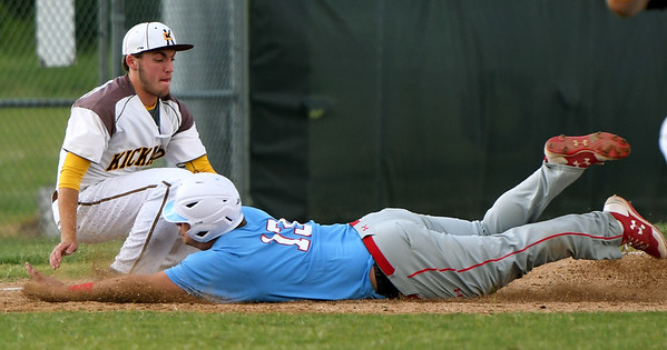 Webb City's Channing Mickey slides safely into third base as Kickapoo's Kolton Giefer fields the throw during their game on Tuesday night in Springfield.<br /> Globe | Laurie Sisk
