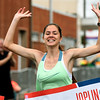 Anne Vernon, of Neosho crosses the finish line with the top time in the women's 5K on Saturday at the Joplin Memorial Marathon.<br /> Globe | Laurie SIsk