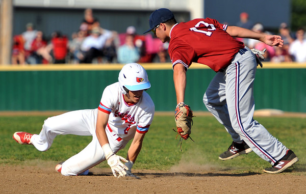 Joplin's Dylan Parker tags out Webb City's Tanner Jones after Jones got caught in a rundown during their Cardinals Class 5 District 12 championship game on Tuesday night at Webb City.<br /> Globe | Laurie Sisk