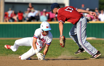 Joplin's Dylan Parker tags out Webb City's Tanner Jones after Jones got caught in a rundown during their Cardinals Class 5 District 12 championship game on Tuesday night at Webb City. Globe | Laurie Sisk