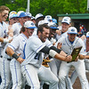 Globe/Roger Nomer<br /> Crowder baseball players celebrate winning the South Central District Championship on Monday at Warren Turner Field.