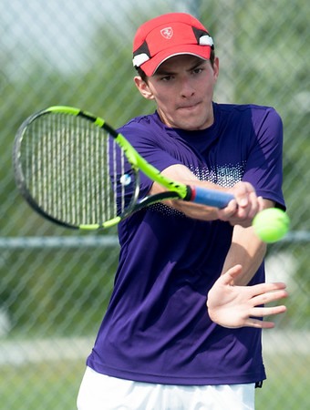 Thomas Jefferson's Tuernon Riesenmy returns a serve as he partners with Joey Cascone for a No. 1 doubles match against Carl Junction's Ben Byrd and Joe Wolf on Wednesday at the Joplin Athletic Complex.<br /> Globe | Laurie Sisk