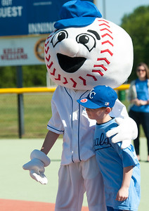 "Danny Wallace gets a little encouragement from Miracle League mascot ""Homer"" during Miracle League action on Saturday at the Will Norton Field of Dreams. Globe 
