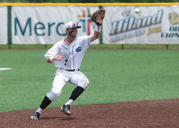 Globe/Roger Nomer<br /> Crowder sophomore Jacob Adams tracks down a bouncing grounder on Monday at Warren Turner Field.