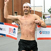 An emotional Kevin Zimmerman, of Springfield breaks the course record enroute to a first place finish in his first-ever marathon on Saturday at the Joplin Memorial Marathon.<br /> Globe | Laurie SIsk