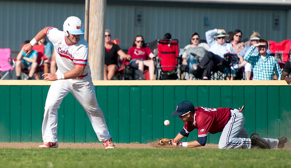 Webb City's Mark Duley gets out of a pickle courtesy of a Joplin error as Joplin first baseman Noah Gaudette fields the throw during their Class 5 District 12 championship game on Tuesday night at Webb City.<br /> Globe | Laurie Sisk