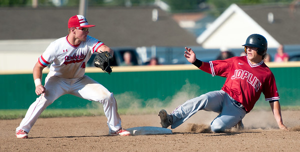 Joplin's Gavin Merriman slides safely into second base as Webb City's Will Larson fields the throw during their Class 5 District 12 championship game on Tuesday night at Webb City.<br /> Globe | Laurie Sisk