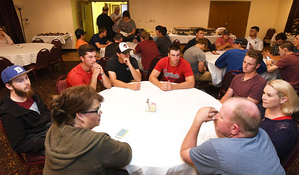 Host families and players get acquainted during a special meet and greet for Outlaws players and families on Wednesday night at the Continental Banquet Center.<br /> Globe | Laurie Sisk