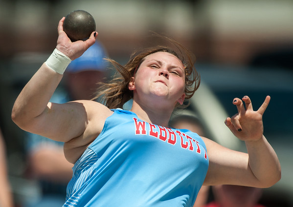 Webb City's Madison Ferguson launches her winning throw in the shot put on Saturday at Carl Junction High School.<br /> Globe | Laurie Sisk
