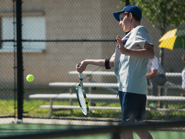 Globe/Roger Nomer<br /> Joplin's Asa Borup hits a shot during doubles competition at Joplin High on Monday.