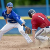 Joplin's Jacob Yarnall slides safely into second base as Carthage shortstop Kaden Kralicek applies a late tag during their Class 5 District 12 championship game on Tuesday night at Carthage's Carl Lewton Stadium.<br /> Globe | Laurie Sisk