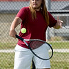 Joplin's Asa Borup  returns a serve during his district match on Tuesday at JHS.<br /> Globe | Laurie Sisk