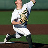 Missouri Southern starter Corbin Osburn delivers a pitch to the plate during the Lions' game against Fort Hays State on Friday night at Warren Turner Field.<br /> Globe | Laurie Sisk