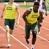 From the left: Missouri Southern's Matt Willis prepares to pass thebaton to teammate Brendan Watkins during the 4x100m relay on Friday at the MSSU Last Chance meet at Missouri Southern.<br /> Globe | Laurie SIsk