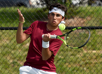 Joplin's Garret Lewis returns a volley during his district match on Tuesday at JHS. Globe | Laurie Sisk