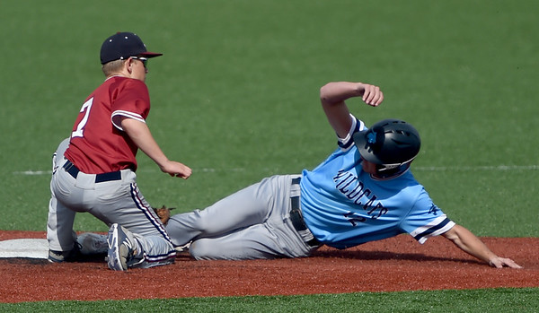 Joplin's Cade Carlson gets the out on Har Ber's Jackson Riley during their game on Thursday at JHS.<br /> Globe | Laurie Sisk