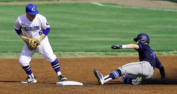 Crowder second baseman Cooper King tags the bag to get the force out on State Fair's Chase Swisher during their game in the NJCAA Region XVI Championships on Thursday at Joe Becker Stadium.<br /> Globe   Laurie SIsk