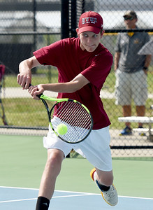Joplin's Nick Mailes returns a volley during his district match on Tuesday at JHS. Globe | Laurie Sisk
